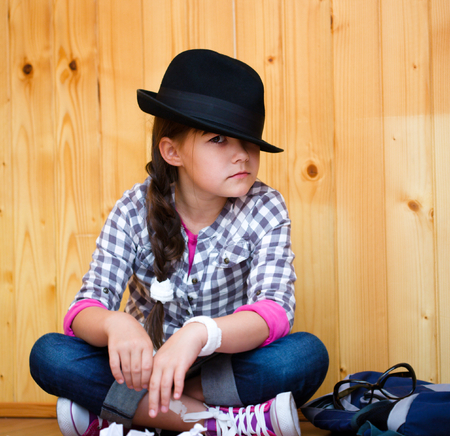 astounded: Portrait of a beautiful girl in a black hat Stock Photo