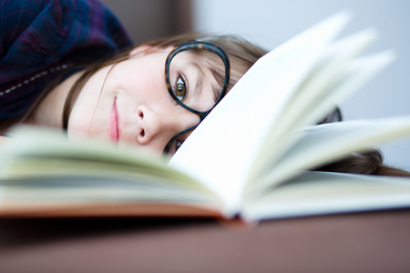 erudition: Cute girl is reading book - school, education concept Stock Photo