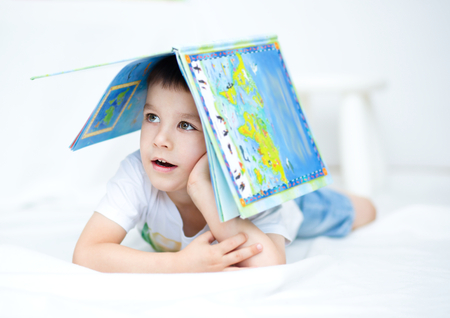 erudition: Cute little boy is reading book