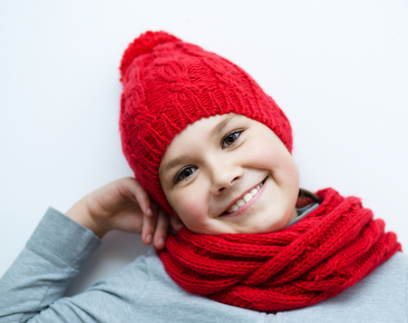 astounded: Cheerful smiling girl wearing a hat and scarf