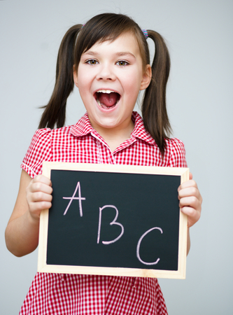 erudition: Cute girl is holding blackboard - education concept Stock Photo