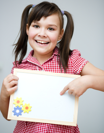Happy girl is holding blank banner Stock Photo