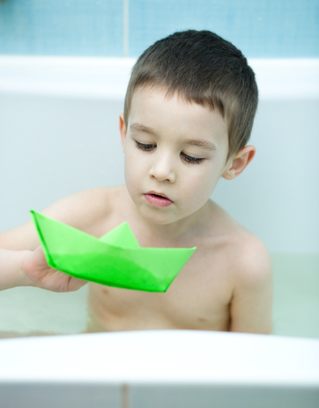 bathwater: Cute child bathes in a bathroom Stock Photo