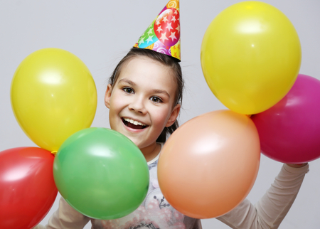 beauty parlour: Cute beautiful girl celebrate her birthday. happy girl with balls