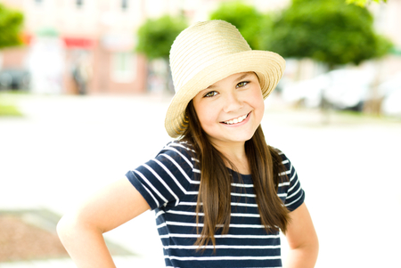 astounded: Portrait of a beautiful girl in bright hat