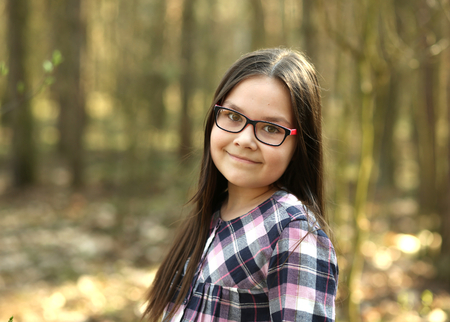 Portrait of a cute beautiful girl in park