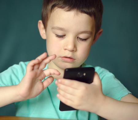 Happy boy using tablet