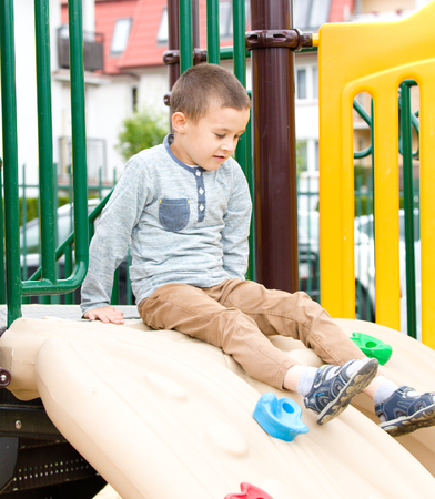Cute little boy is playing on playground