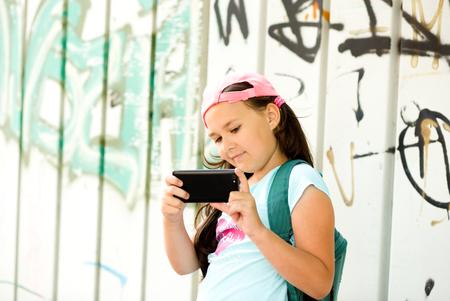 Happy cute girl having fun taking selfie outdoors