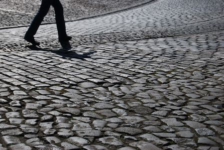 tourist walking up the cobblestone pavement of Edinburgh castle photo