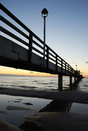 pier going out into the Baltic Sea at dusk photo