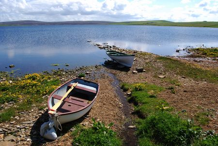 mainland: fishing boat at the Loch of Boardhouse on Orkney Mainland Stock Photo
