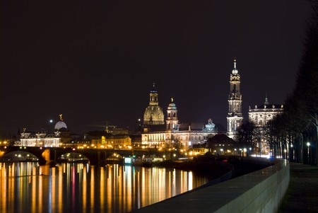 view of the skyline of Dresden at night with the river Elbe photo