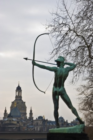 dresden: famous statue of the Archer in Dresden, Saxony with the Frauenkirche in the background