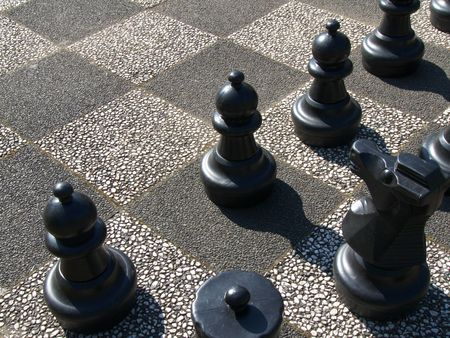 part of an outdoor chess playfield with some black figures Stock Photo - 4786620