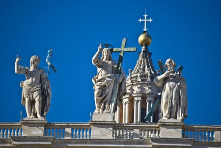 some of the statues of the apostel on the roof of San Pietro photo