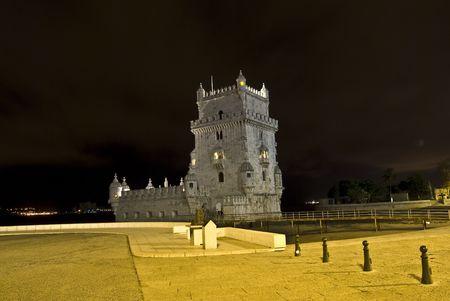 belem: famous Torre de Belem illuminated at night Editorial