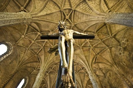 jesus on the cross and a part of the ceiling of the church of the Mosteiro dos Jeronimos