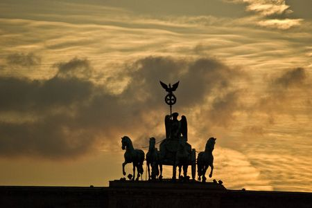 west gate: quadriga on top of the Brandenburger Tor in Berlin at sunset Stock Photo