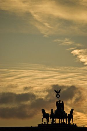 quadriga on top of the Brandenburger Tor in Berlin at sunset photo