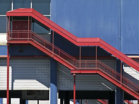 red staircase leading into the upper floor of a blue building Stock Photo - 4991251