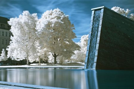 monument for the wall in Berlin changed into a waterfall, photo taken with an infrared filter