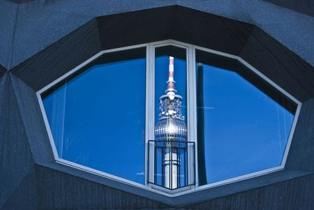communists: distorted reflection of the Fernsehturm in a modern building