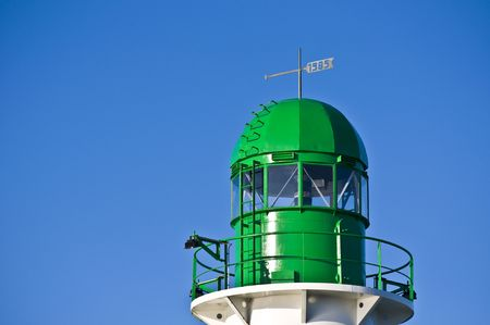 detail of the green lighthouse at the harbor of Warnemuende photo