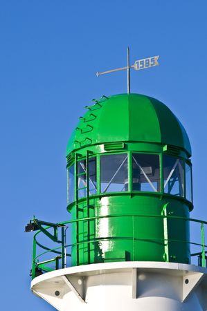 starboard: detail of the green lighthouse at the harbor of Warnemuende Stock Photo