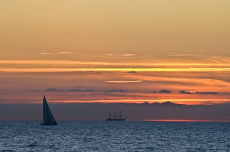 beautiful sunset with a big sailing boat photo