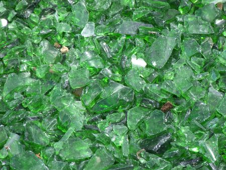 many pieces of broken glass in green photo