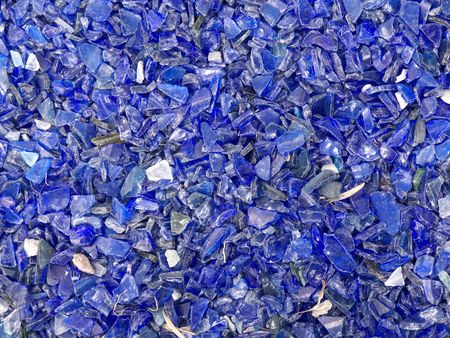 many broken pieces of glass in blue photo