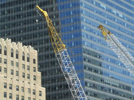 Tower crane in front a modern office building photo