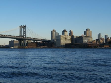 part of the Manhattan bridge with Brooklyn in the background photo