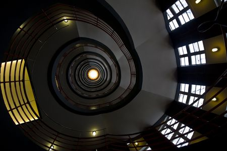looking upwards in a beautiful old spiral staircase photo