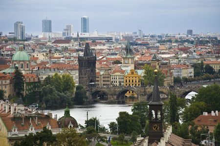 view of the Charles bridge and the cityscape of Prague photo