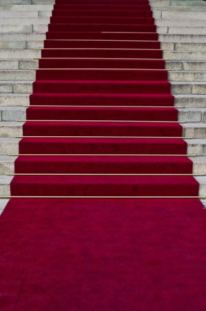 beautiful red carpet leading up old steps  photo
