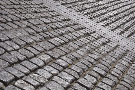 detail of a road with old cobblestones photo