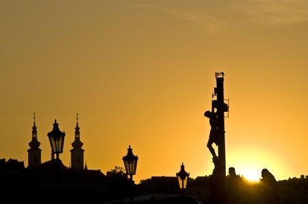 beautiful sunset at the Charles bridge in Prague photo