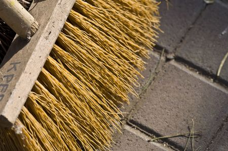 closeup of a wooden broom on the floor Stock Photo