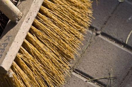 closeup of a wooden broom on the floor Standard-Bild