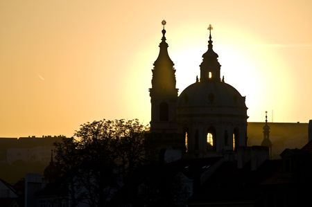 nicolas: sunset behind St Nicolas in Mala Strana in Prague Stock Photo