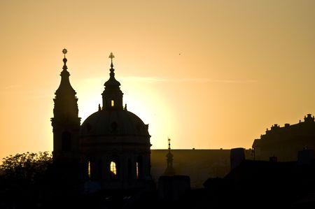sunset behind St Nicolas in Mala Strana in Prague photo