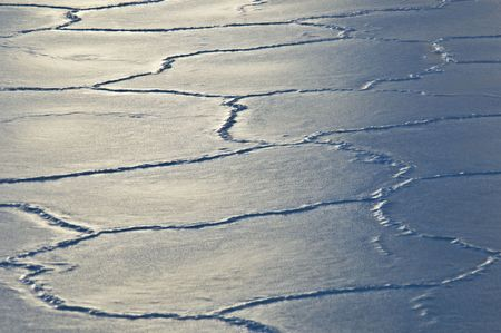 cracks in ice: sun reflecting on ice floes with many cracks Stock Photo