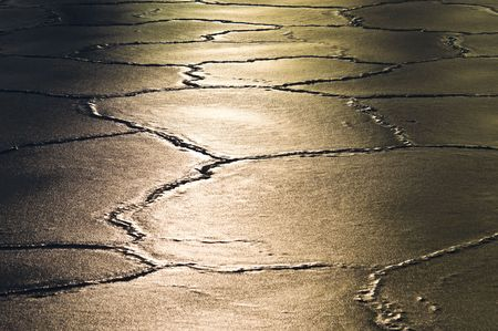 sun reflecting on ice floes with many cracks Stock Photo - 6275619