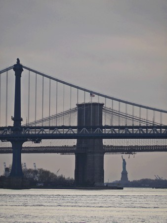 view of Brooklyn Bridge, Manhattan Bridge and Statue of Liberty in New York City photo