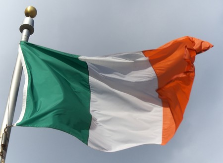 irish flag blowing in the wind on a sunny day photo