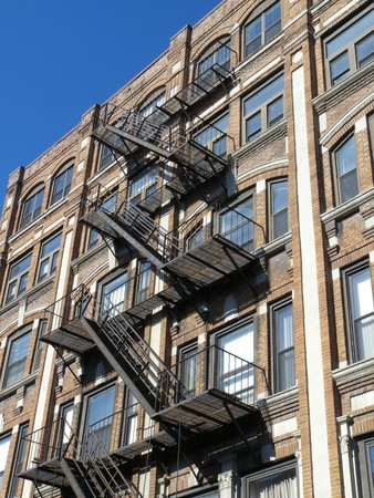 detail of old houses with a metal staircase in Boston photo