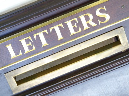 detail of an old wooden letter box