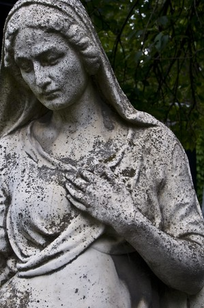 gothic angel: detail of an old marble fombstone at the central cemetery in Vienna